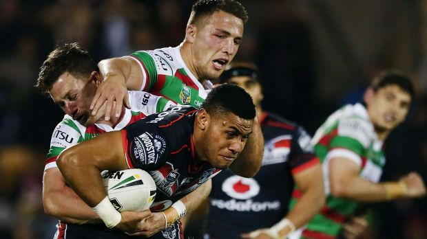 Hard yards: David Fusitu'a of the Warriors is tackled by Damien Cook and Sam Burgess.