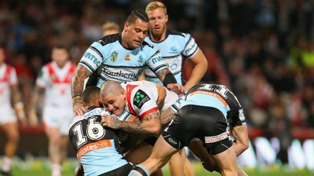 Surrounded: Russell Packer is taken in a three-man tackle.
