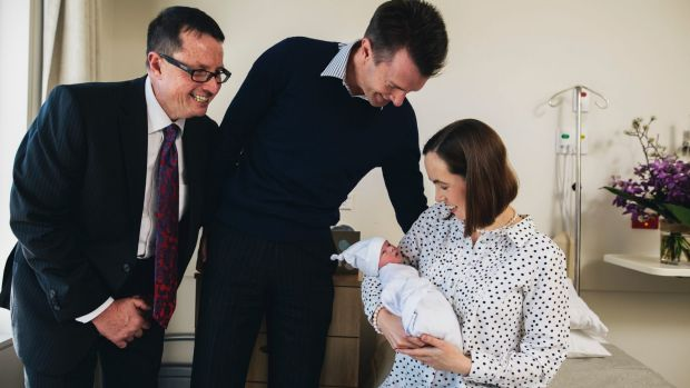 Pregnant Pause advocator Professor Steve Robson with new parents Andrew and Karina with their son Nicholas at John James ...
