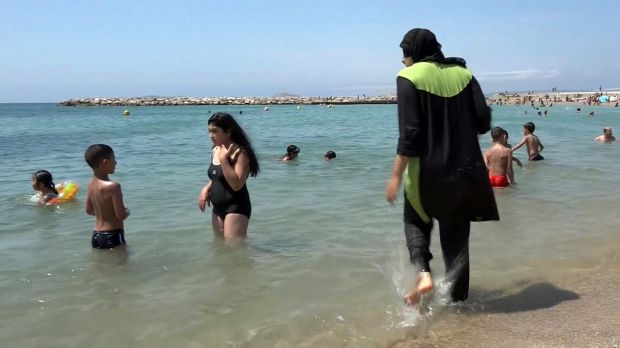 A woman wears a burkini at a beach in Marseille in southern France.