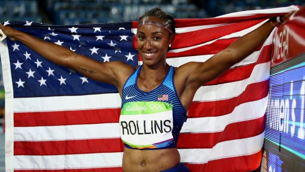 Rollins celebrates after winning the gold medal in the 100 hurdles in Rio.