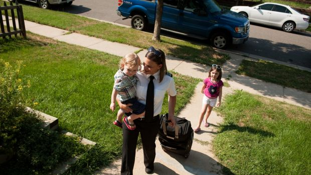First Officer Brandy Beck, a pilot for Frontier Airlines, at home with her children in Denver.