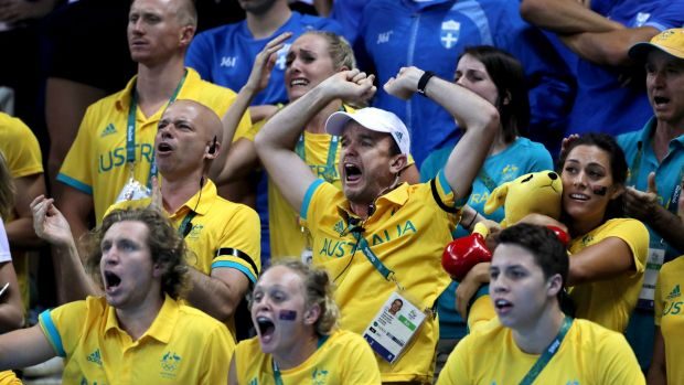 United: members of the Australian swim team cheer Mack Horton during the 400m final in Rio.