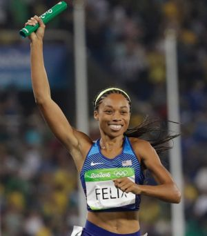 United States' Allyson Felix crosses the line.