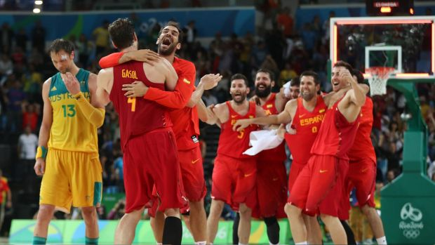 Spain's players celebrate winning the bronze medal match.