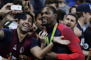 Smile: Kevin Durant takes selfies with fans after winning the men's basketball gold medal.