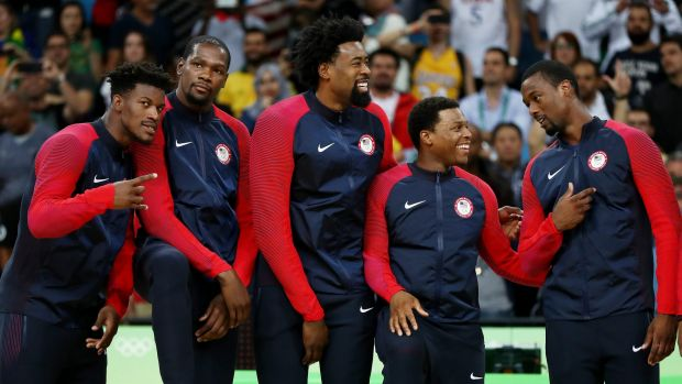 Winners are grinners: Jimmy Butler, Kevin Durant, DeAndre Jordan, Kyle Lowry, and Harrison Barnes wait for the medal ...