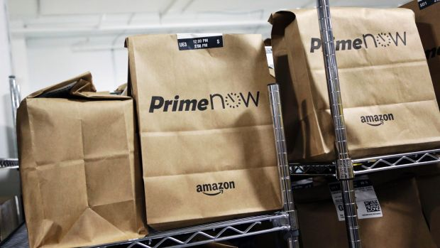 Bags of goods ready for delivery at Amazon's Prime Now urban fulfillment facility in New York.