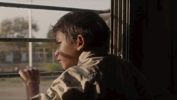 Lost on a train ... Saroo as a boy.