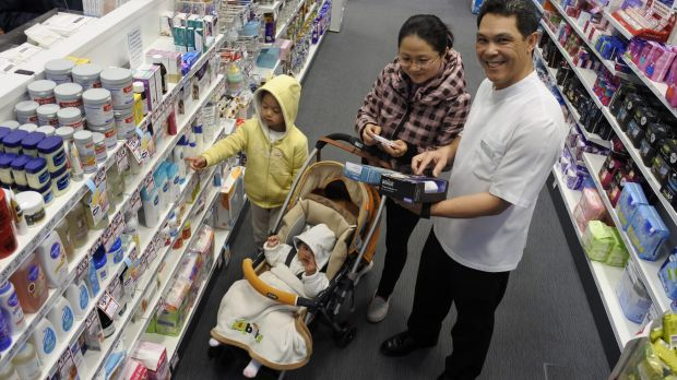 Pharmacist Ben Jackson with Cherry Yang and children Adam, 4, and Sophia, 6 months.