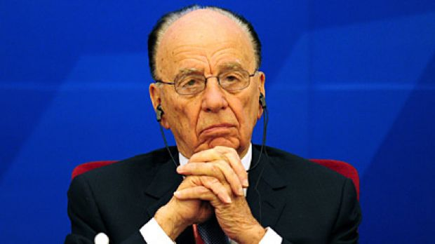 Opportunity knocks... Rupert Murdoch urged Beijing to open the digital door to the future.