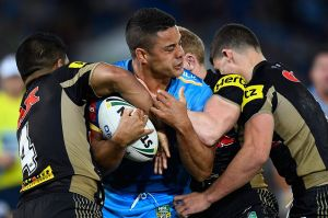 Marked man: Jarryd Hayne is tackled by a gang of Panthers.