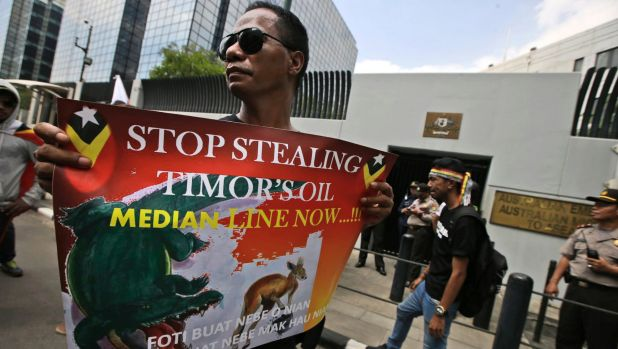 A protester during a rally last year outside the Australian Embassy in Jakarta, as dozens of people show their support ...