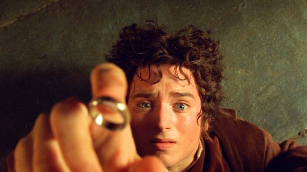 """Elijah Wood's character Frodo reaches for the """"One Ring"""", in the film the Fellowship of the Ring"""