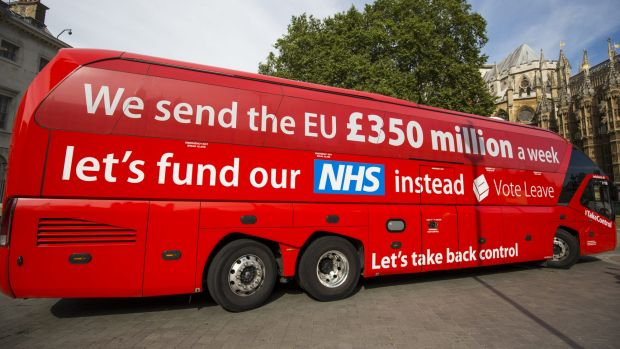 A ''Vote Leave'' battle bus is parked outside the Houses of Parliament in Westminster by Greenpeace before being ...