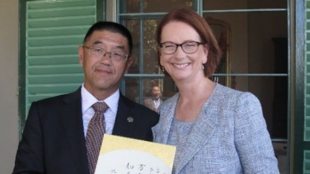 Dr Zhu with prime minister Julia Gillard in February 2013.