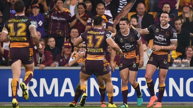 James Roberts of the Broncos celebrates scoring a try against the Roosters at Suncorp Stadium on Thursday night.