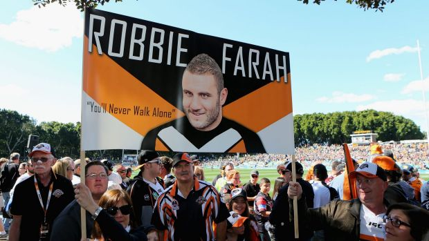Departing son: The Robbie Farah faithful pay tribute to their hero.