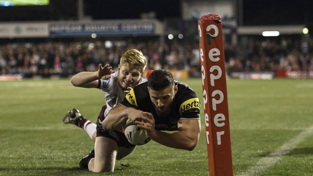 Josh Mansour crosses the line for the first of the Panthers' six tries.