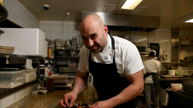 Shane Delia plating the poached mussels with saffron and moghrabieh couscous served at his restaurant Maha.
