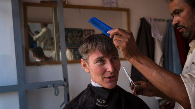 "Ayres at a barber's shop in central Afghanistan:  his first outwardly ""male"" activity in a  country with extreme gender ..."