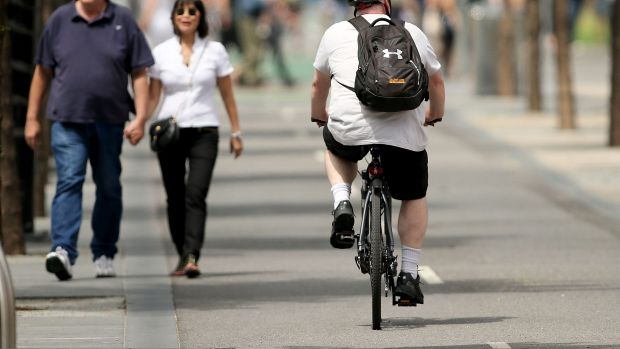 Research has found bike helmet laws, combined with bike lanes and other safety measures to separate cyclists from ...
