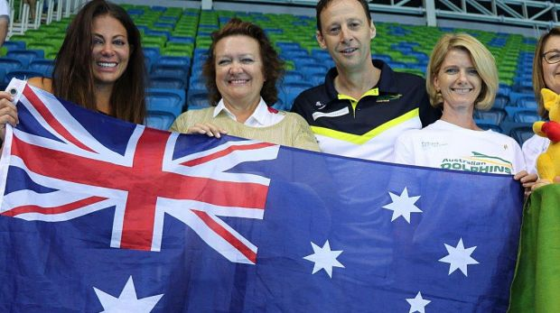 Gina Rinehart and others holding up an Australian flag at the Rio olympics in Brazil
