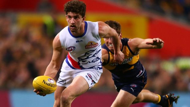 Tom Liberatore helps the Bulldogs to an elimination final win over West Coast last year. A last-round wildcard weekend ...