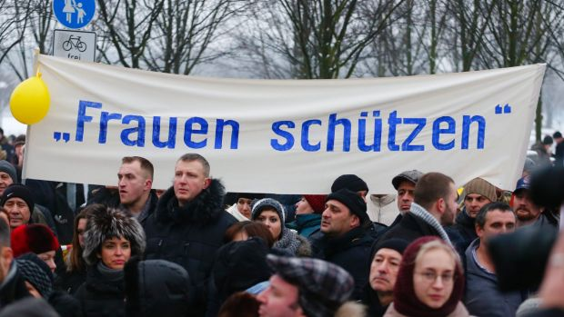 Grassroots or astroturfing?: The 'International Convention of German Russians' protest  in Berlin under a sign that ...