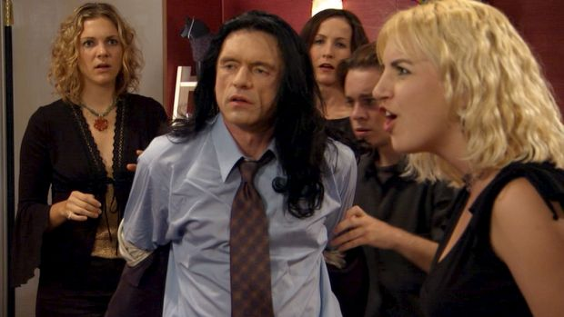 Tommy Wiseau (centre) in a still from his film The Room.