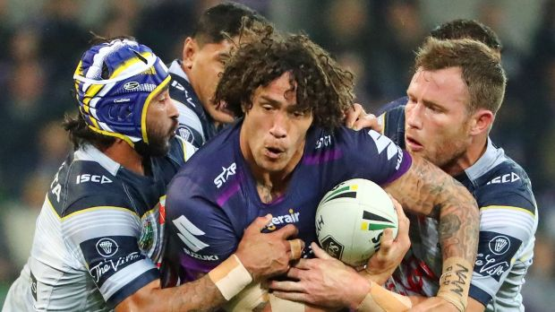 Centre of attention: Melbourne's Kevin Proctor had his hands full against the Cowboys on Saturday night.