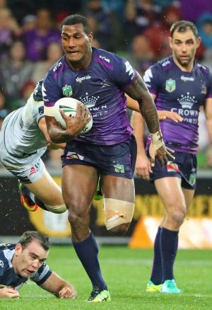 Storm's Suliasi Vunivalu runs away to score Melbourne's first try.