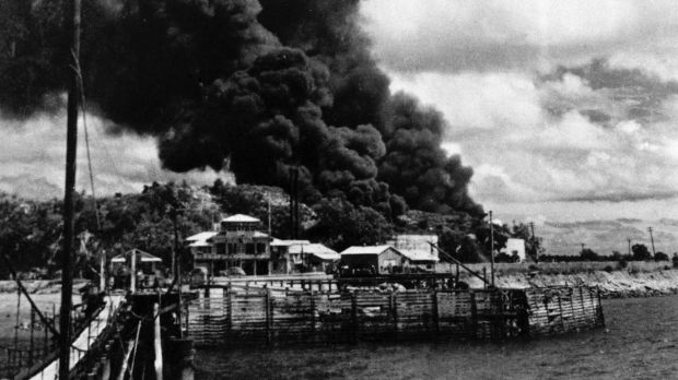 Oil tanks on fire in Darwin after the 1942 bombings.