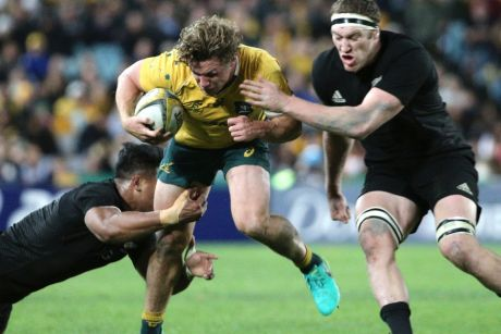 Michael Hooper is tackled by New Zealand's Julian Savea and Brodie Retallic during the Bledisloe Cup in 2016.