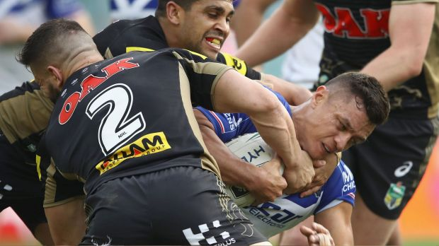 Sam Perrett meets the Panthers defensive line on Sunday afternoon.