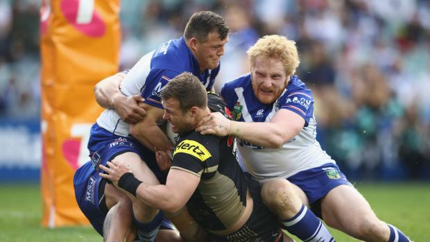 Running men: Trent Merrin and the Panthers.