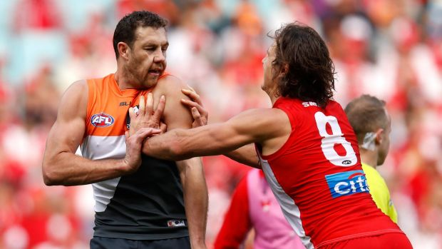 Fiery clash: Kurt Tippett and Shane Mumford wrestle during the 2016 AFL First Qualifying Final between the Sydney Swans ...