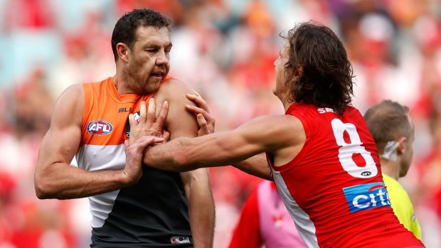 The Giants' Shane Mumford and the Swans' Kurt Tippett square off in the semi-final last September.