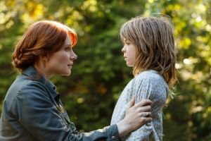 Bryce Dallas Howard is Grace and Oakes Fegley is Pete in Disney's Pete's Dragon, the adventure of an orphaned boy and ...