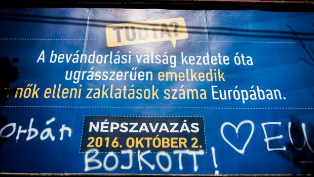 Pro-European Union graffiti calls for a boicott of the referendum on a government poster in Budapest.