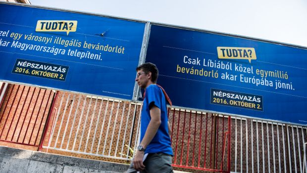 A pedestrian walks past migration referendum billboard posters by the government's Tudta? (Did you know?) campaign in ...
