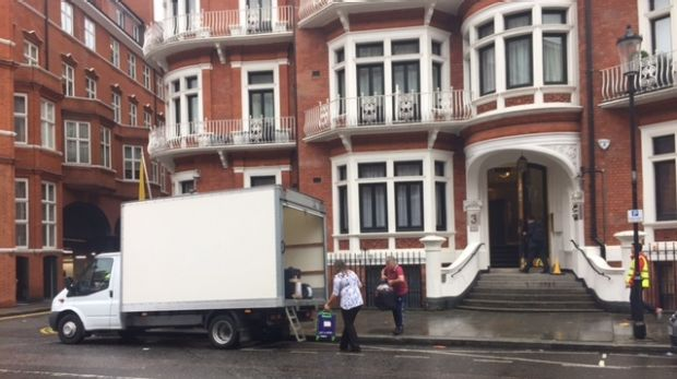 Suitcases being loaded into a truck outside the Ecuador's London embassy on Friday.