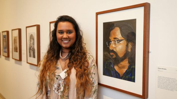 Young Archibald Prize winner of the 16-18 years category, Dilara Niriella, with her portrait of her father.