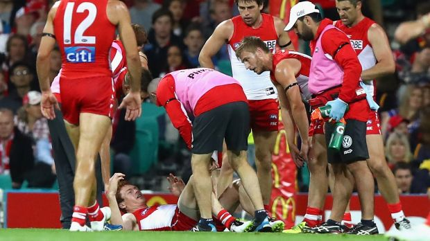 Ouch: Gary Rohan reacts after injuring his knee.