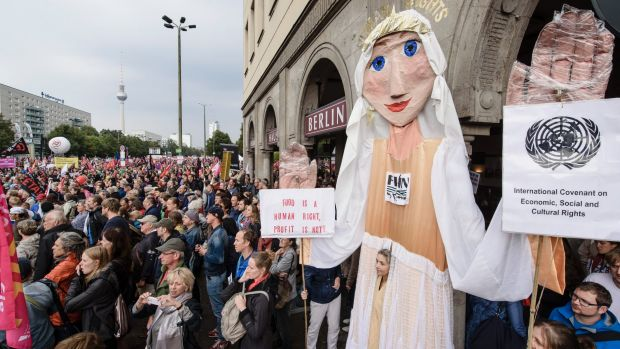 In 2016, protesters demonstrate against the free trade agreements with a giant puppet in Berlin, Germany.