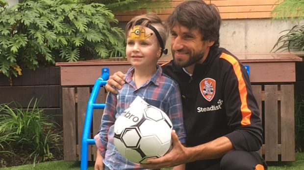 Ole Walton, who was born with microtia, with Brisbane Roar's Thomas Broich at the Hear and Say Centre.