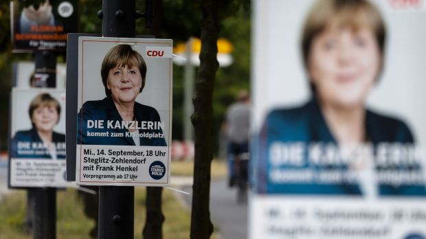 A poster with German Chancellor Angela Merkel, announcing an election rally of her Christian Democratic Union party for ...