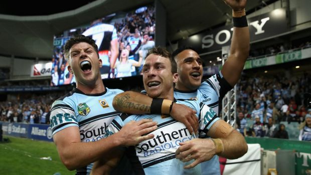 Party time: Chad Townsend, James Maloney and Valentine Holmes celebrate.