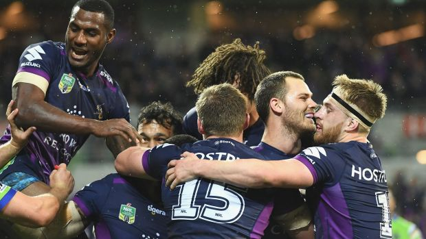 Breakthrough: Cheyse Blair of the Storm is congratulated after scoring a try.