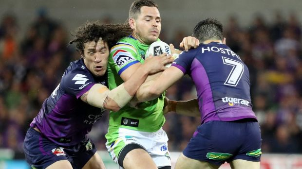Into traffic: Aiden Sezer is challenged by Kevin Proctor and Cooper Cronk.
